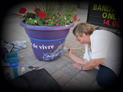 Paulyne Charron, one of the executive members of Expressions! West Nipissing Art Gallery, was one of the several local artists who painted the flower pots this year in downtown Sturgeon Falls.