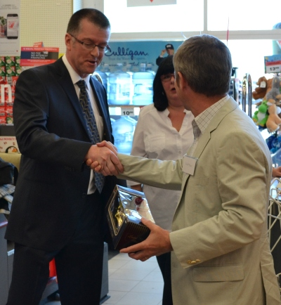 Pierre Marchand of Canadian Tire being congratulated at the grand opening of the expanded store.